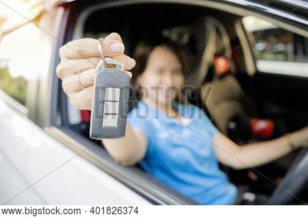 A Woman Who Is Glad She Has Bought A New Car. She Is Proudly Holding The Car Keys, Can Reach The Ach