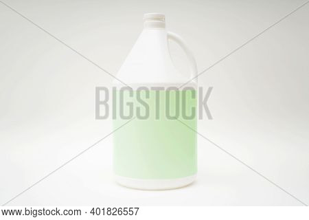 White Plastic Packaging Placed On A White Background. Green Label Floor For Text, Images, Advertisin