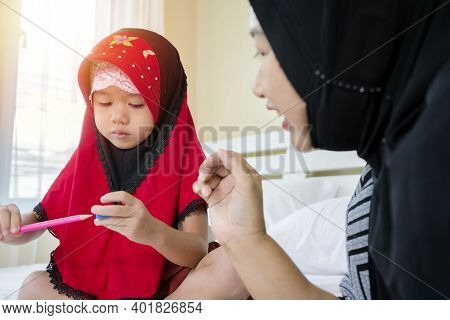 A Muslim Girl, She Is A Crayon With Her Grandmother Caring Nearby. Family Ties Are Very Important. E