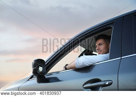Handsome Man Driving His Modern Car, Low Angle View
