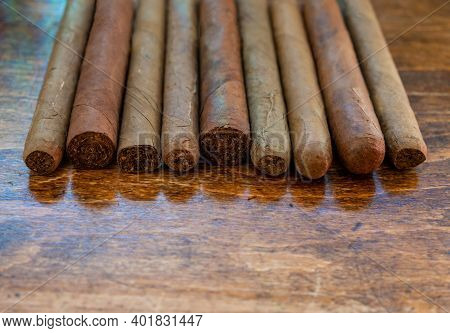 Cuban Cigars Variety On Wooden Office Desk, Closeup View