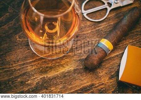 Cuban Cigar And Whiskey On Wooden Desk