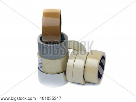 Rolls Of Insulation Adhesive Tape, Multi Colored Ribbons On A White Background. Bright And Colorful