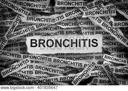 Bronchitis. Torn Pieces Of Paper With The Word Bronchitis. Black And White. Close Up.