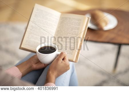 Unrecognizable Black Lady With Coffee Reading Book, Enjoying Peaceful Morning At Home, Free Space. C