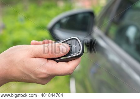 Woman Lock Or Unlock Her Car With Car Remote Control