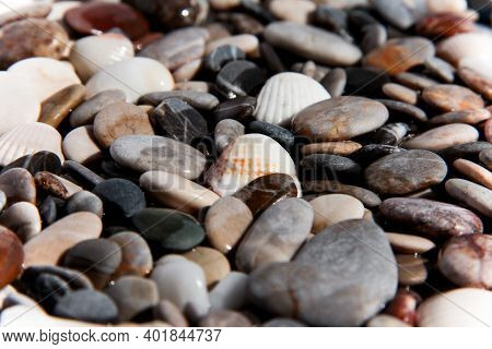 Background From Multi-colored Stones. Texture Of Sea Stones. Red And Blue Pebbles. Stone Beach. Mine