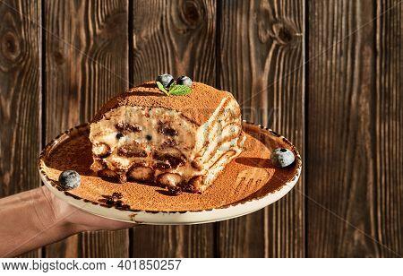 Tiramisu Is A Traditional Italian Dessert. Homemade Tiramisu Cake Decorated With Mint Leaves And Blu