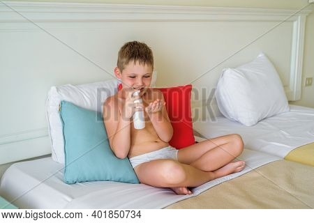 Sunburn On A Child. Solar Allergy On The Cheeks Of A Boy, A Sun Burn In A Child.sun Protection, Baby