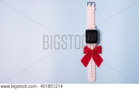 White Electronic Watch With A Bow On A Plain Background . The Watch Is Handmade With A Bow . Gift Wa