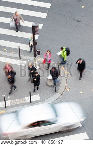 Aerial View Of People Crossing A Street In The City