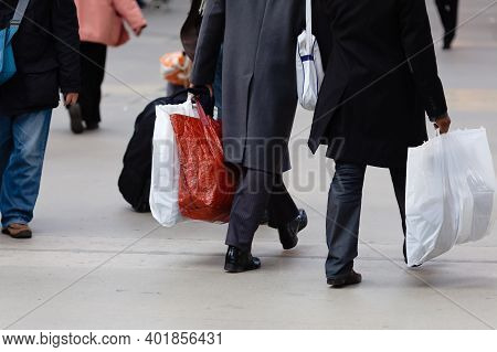 Men With Shopping Bags In The City