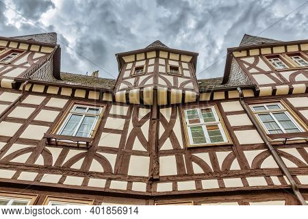 Picture Of An Old Half-timbered House With Dark Overcast Sky