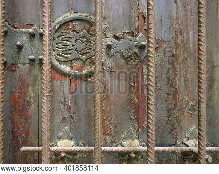 Antique Metal Ornamental Detail On Rusty Wrought Iron Wall And Grilles. Rusty Painted Old Ornate Dec
