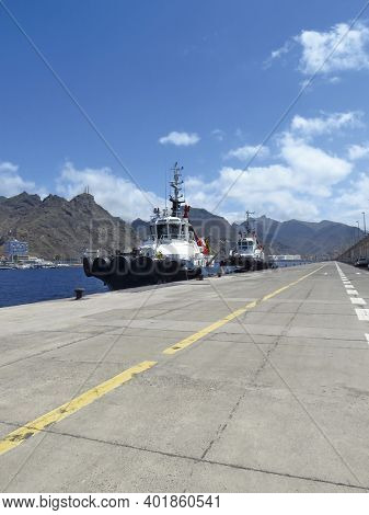 Perspective View Of Tug Boat Docked At Port Dock. Professional Boat For Port Work. Large Tugboat Ber