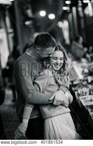 Love, Travel, Tourism, Relationship And Dating Concept - Romantic Happy Couple Hugging In Street.