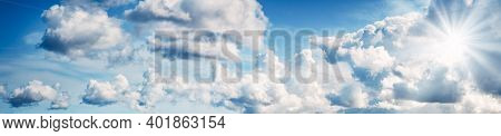 White Fluffy Clouds On Blue Sky In Summer