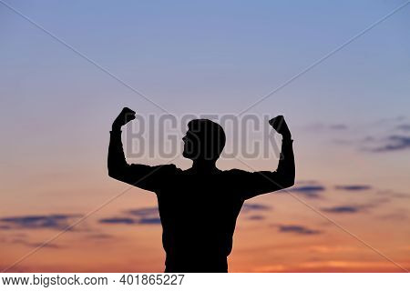 Men Silhouette At Sunset, Human Body Over Natural Colorful Sky Background, Hands Up Having Fun, Happ