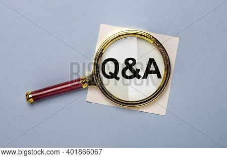 Q Concept. Q And A Inscription Through Magnifying Glass