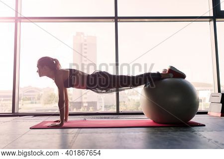 Shot Of Fitness Woman On Exercise Mat. Female Athlete Lying On Her Back After A Gym Workout