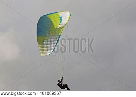 Paraglider Flying Wing In A Cloudy Sky