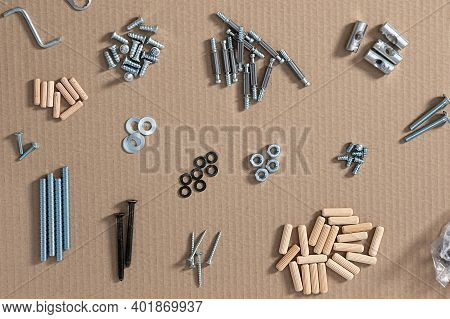 Types Of Fastening Tools For Furniture On The Floor. Top View Of Fasteners Sorted By Type.assembly C