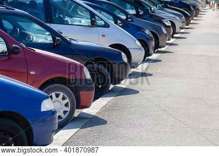 Row Of Cars At A Parking Lot