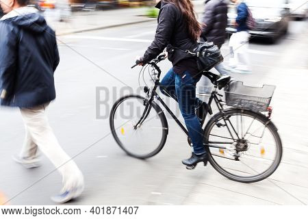 Picture With Camera Made Motion Blur Effect Of A Bicycle Rider Crossing A City Street