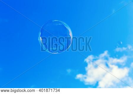 Picture Of A Soap Bubble Flying In Front Of The Sky
