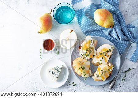 Blue Cheese Pear Thyme Toasts In A Plate