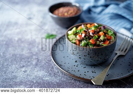 Green Lentil Red Bell Pepper Cucumber Parsley Salad In A Bowl