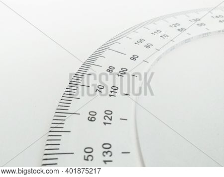 Close Up Of Protractor For Measuring Degrees Isolated On White Background. Math Instrument For Measu