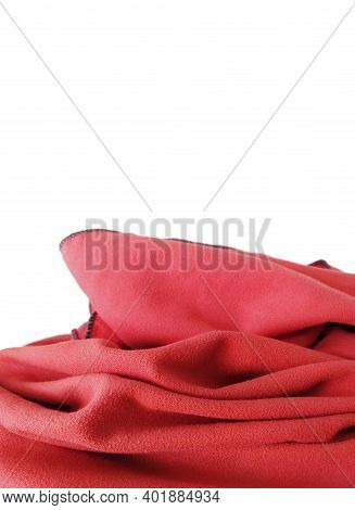 Wrinkled Red Microfiber Cloth Isolated. Red Soft Beach Or Bath Towel Folds Texture Isolated On White