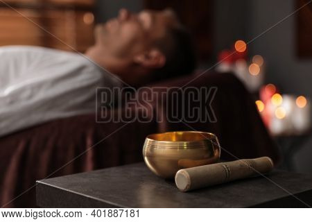 Man At Healing Session In Dark Room, Focus On Singing Bowl