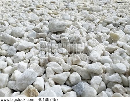 White Small Rounded Stone Texture. White Pebbles Stone Texture And Background. Abstract Small Stone