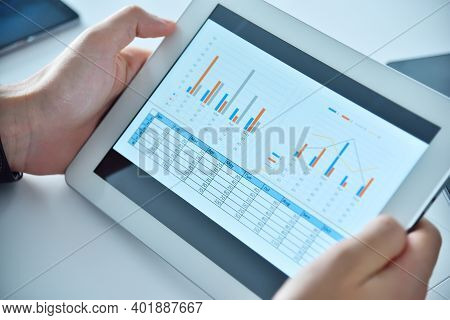 Businessman Hands Using Digital Tablet With Business Report. Business And Financial Success Concept.