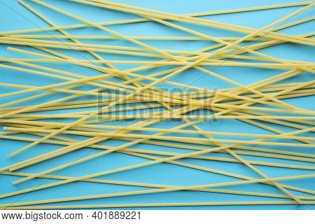 The Detail Of Some Spaghetti On A Blue Surface
