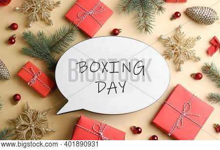 Speech Bubble With Phrase Boxing Day And Christmas Decorations On Beige Background, Flat Lay
