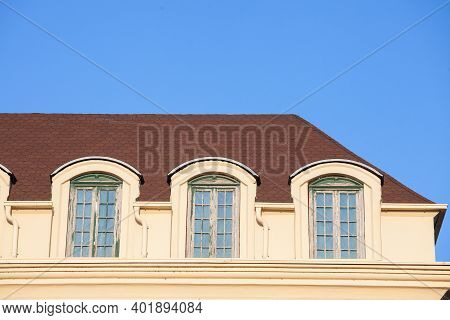 Dormer And Windows On The Roof Of A Residential Building Made Of Flats And Appartments, Some For Ren