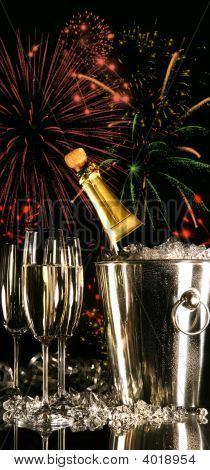 Glasses Of Champagne With Fireworks
