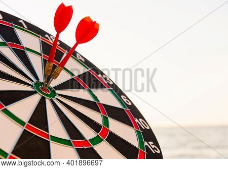 Closeup The Dart Arrow Hit Center On Bullseye(bull's-eye) Of A Dartboard Is A Target Of Challenge Bu