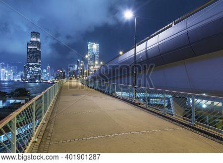 Promenade And Skyline Of Hong Kong City At Night