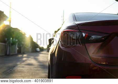 Close Up Car On Street Automotive Roadtrip On Sunset Background For Transport, Travel Of Nature To V
