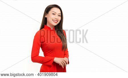 Beautiful Young Asian Woman Wearing Vietnam Traditional Culture Red Ao Dai Dress, Vietnam