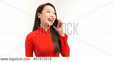 Beautiful Vietnam Women Wearing Ao Dai Vietnam Traditional Dress Standing And Talking On Smartphone