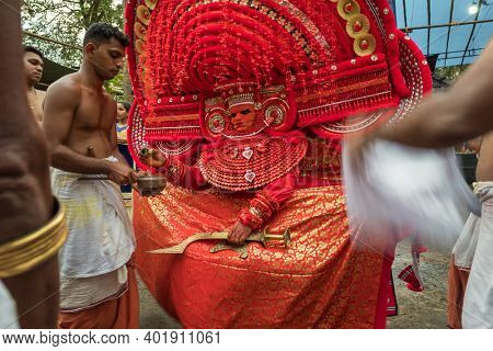 Kannur, India - December 2, 2019: Theyyam artist perform during temple festival in Kannur, Kerala, India. Theyyam is a popular ritual form of worship in Kerala, India