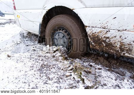 The Car Stalled In The Mud In Winter. Minivan Stalled In The Mud. Wrong, Bad Wheel Tread For Off Roa