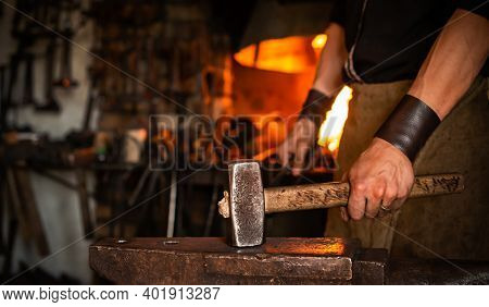 Blacksmith Performs Forging Of Hot Glowing Metal On Anvil, Blacksmith Manually Forging Molten Metal