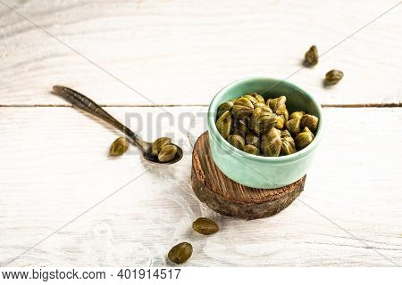 Marinated Capers In A Ceramic Bowl. Edible Flower Buds Of Capparis Spinosa, Caper Bush Or Flinders R