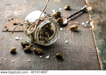 Pickled Capers On A Dark Wooden Background. Edible Flower Buds Of Capparis Spinosa, Caper Bush Or Fl